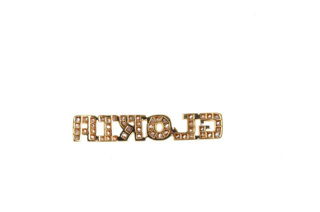 A diamond nameplate. The brilliant-cut diamond script - 2