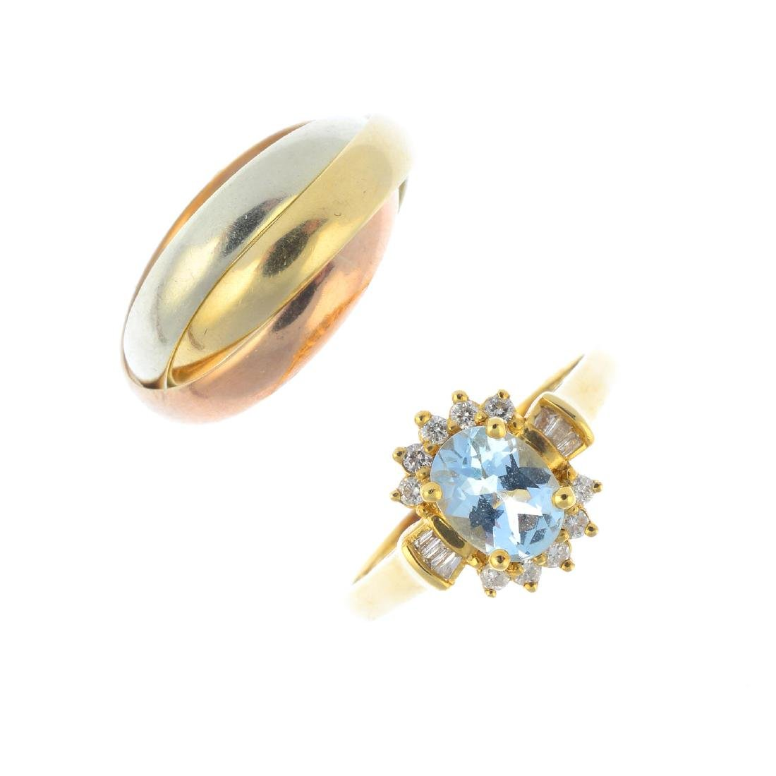 A 9ct gold band ring and an aquamarine and diamond