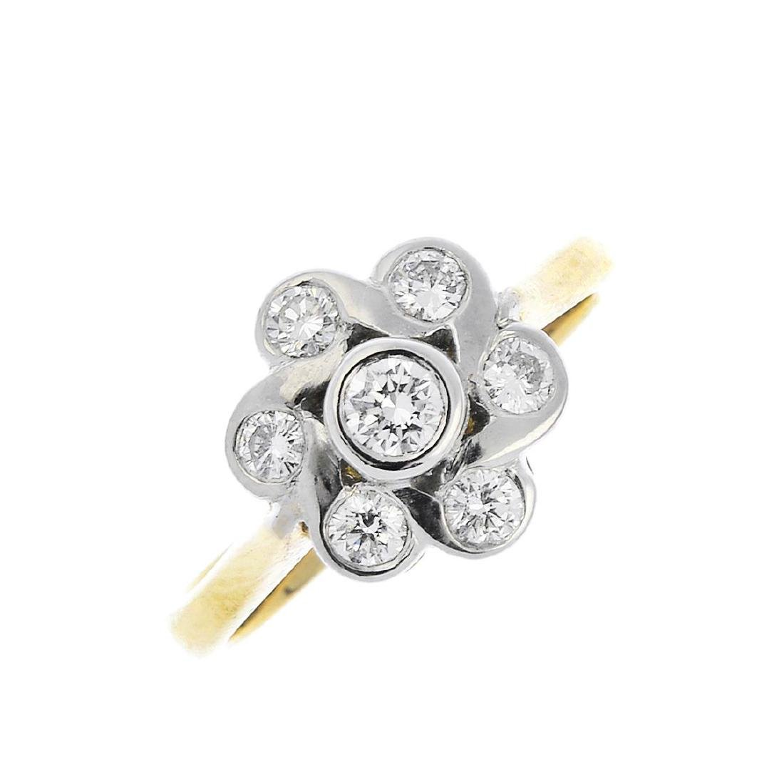 An 18ct gold diamond cluster ring. The brilliant-cut