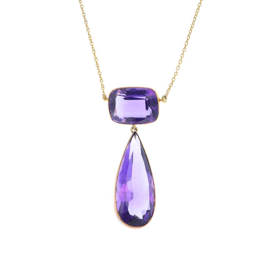 An amethyst pendant. The pear-shape amethyst collet,