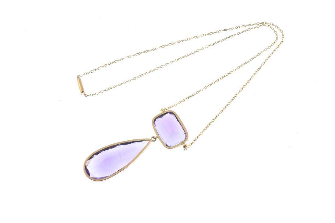 An amethyst pendant. The pear-shape amethyst collet, - 2