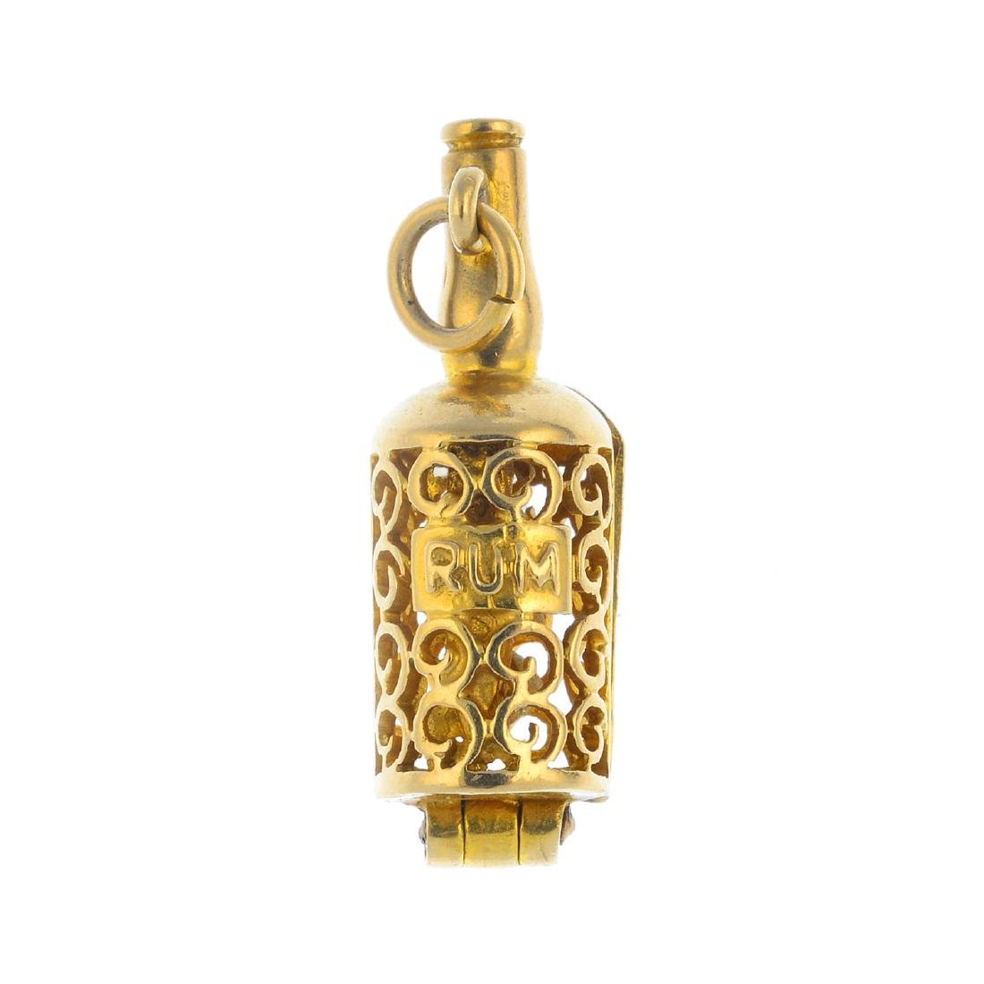 A 9ct gold 'Ship in a bottle' charm. The openwork
