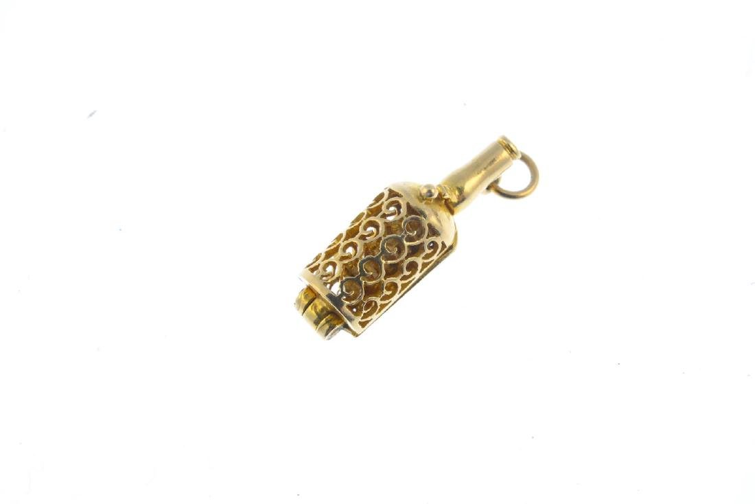 A 9ct gold 'Ship in a bottle' charm. The openwork - 2