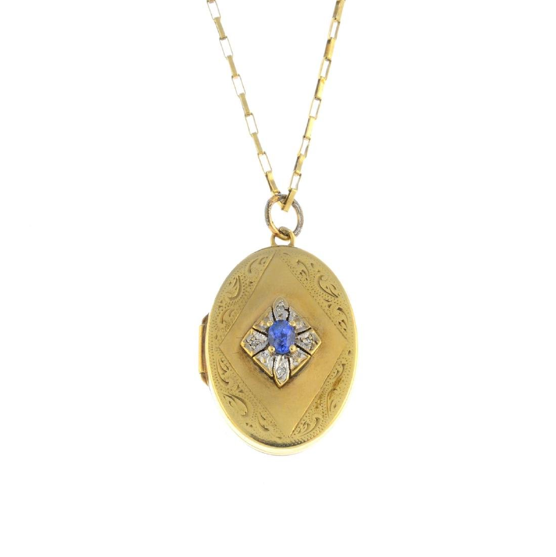 A sapphire and diamond locket. Of oval outline, the