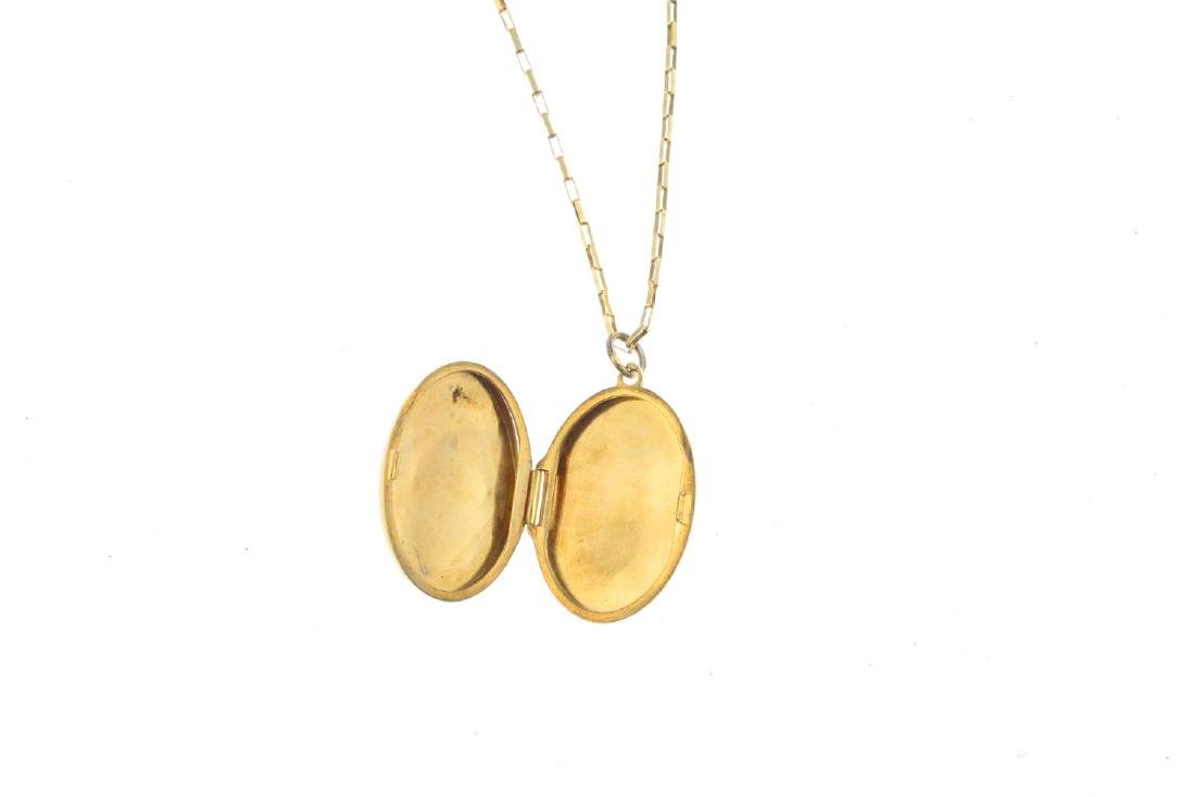A sapphire and diamond locket. Of oval outline, the - 2