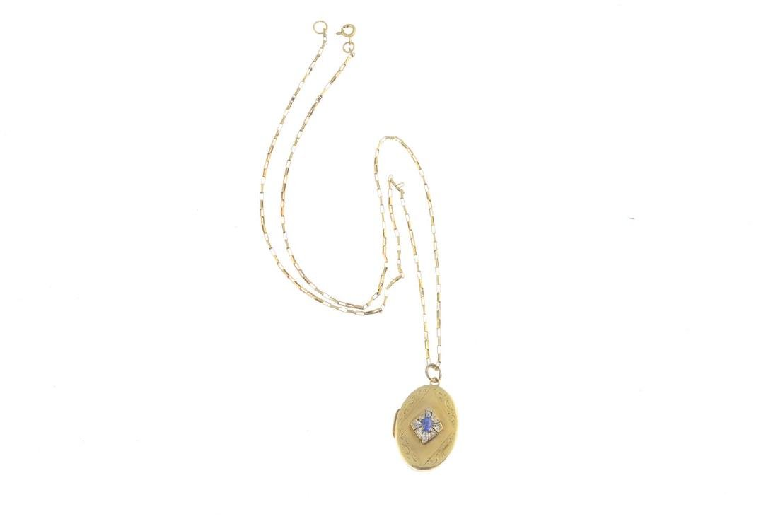 A sapphire and diamond locket. Of oval outline, the - 3