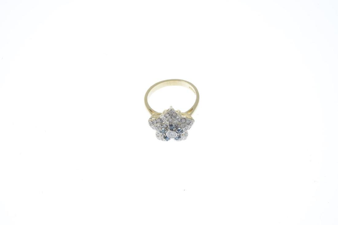 An 18ct gold diamond and sapphire cluster ring. The - 2