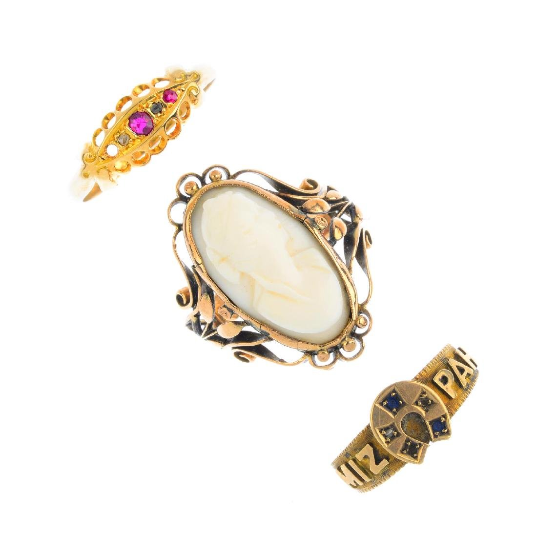 Three gem-set rings. To include a shell cameo dress
