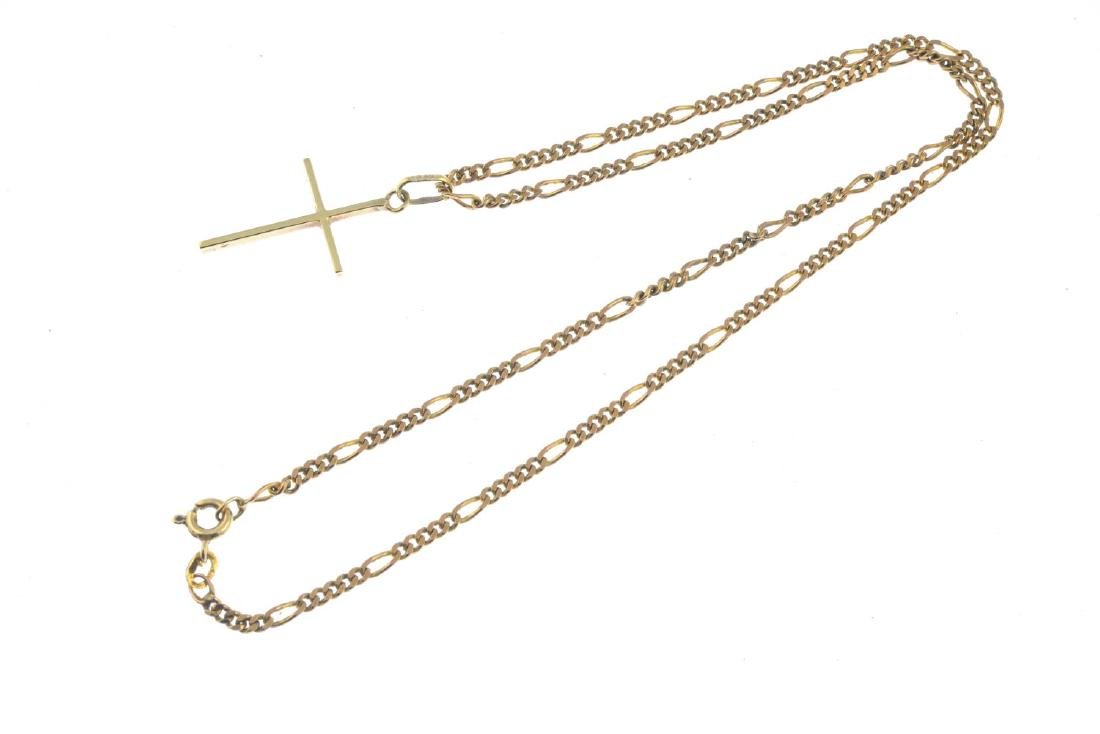 A 9ct gold cross pendant. The cross, suspended from a - 3