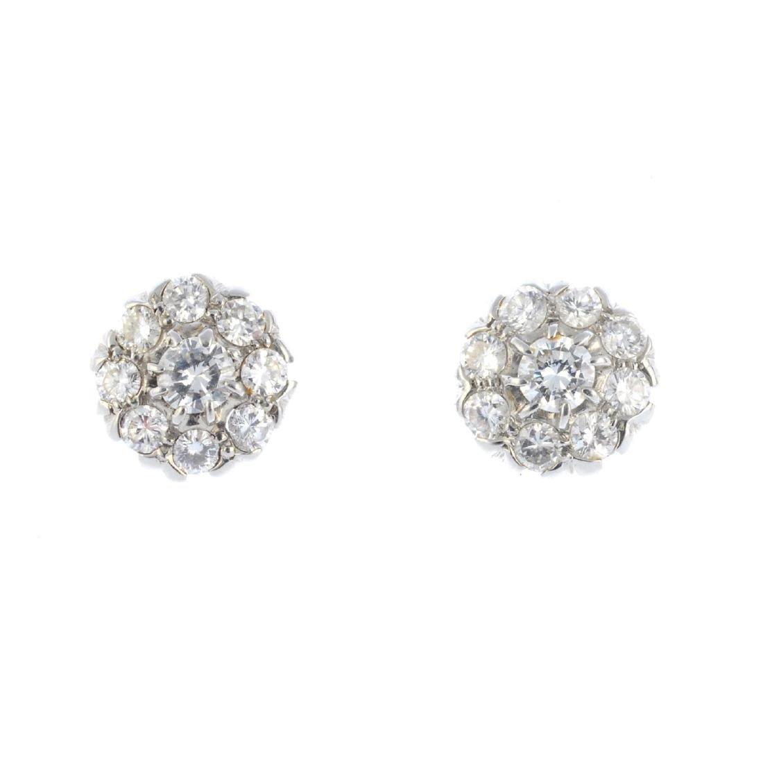 A pair of diamond cluster earrings. Each designed as