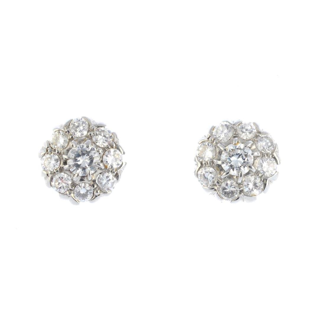A pair of diamond cluster earrings. Each designed as