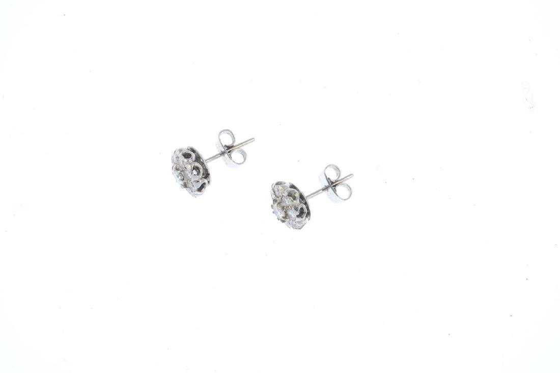 A pair of diamond cluster earrings. Each designed as - 2