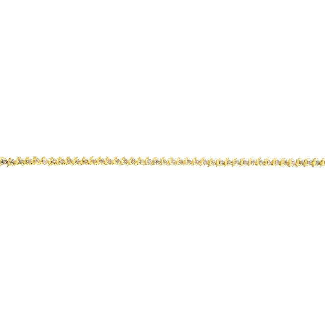 A 9ct gold diamond bracelet. Designed as a