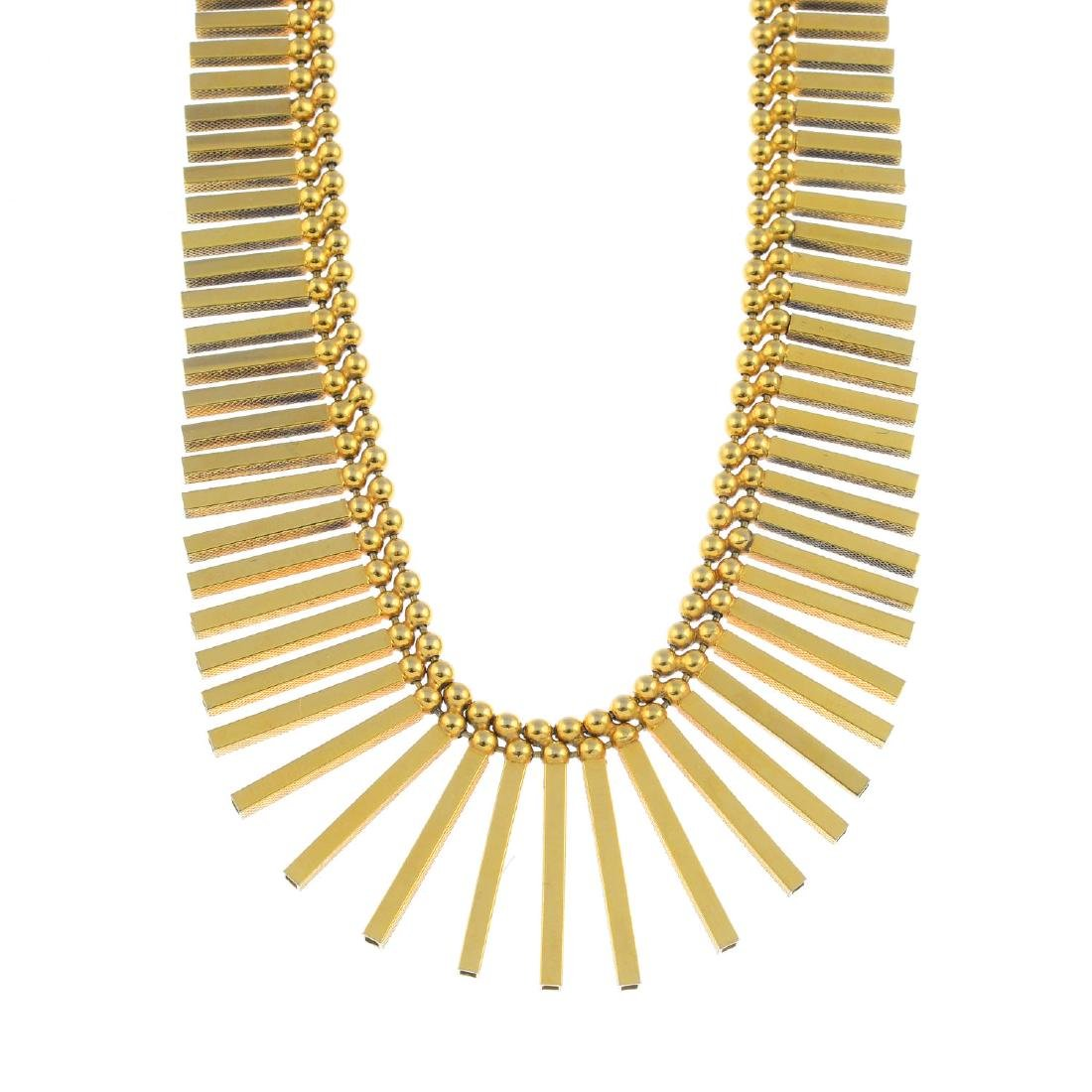 A 1970s 9ct gold necklace. Designed as a graduated