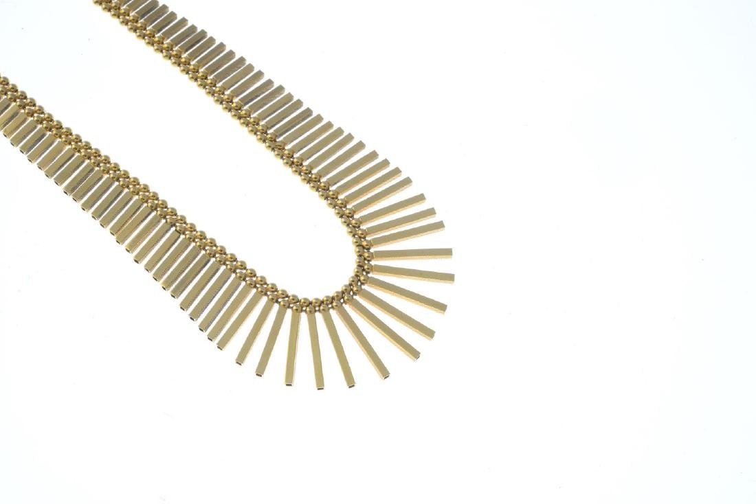 A 1970s 9ct gold necklace. Designed as a graduated - 2