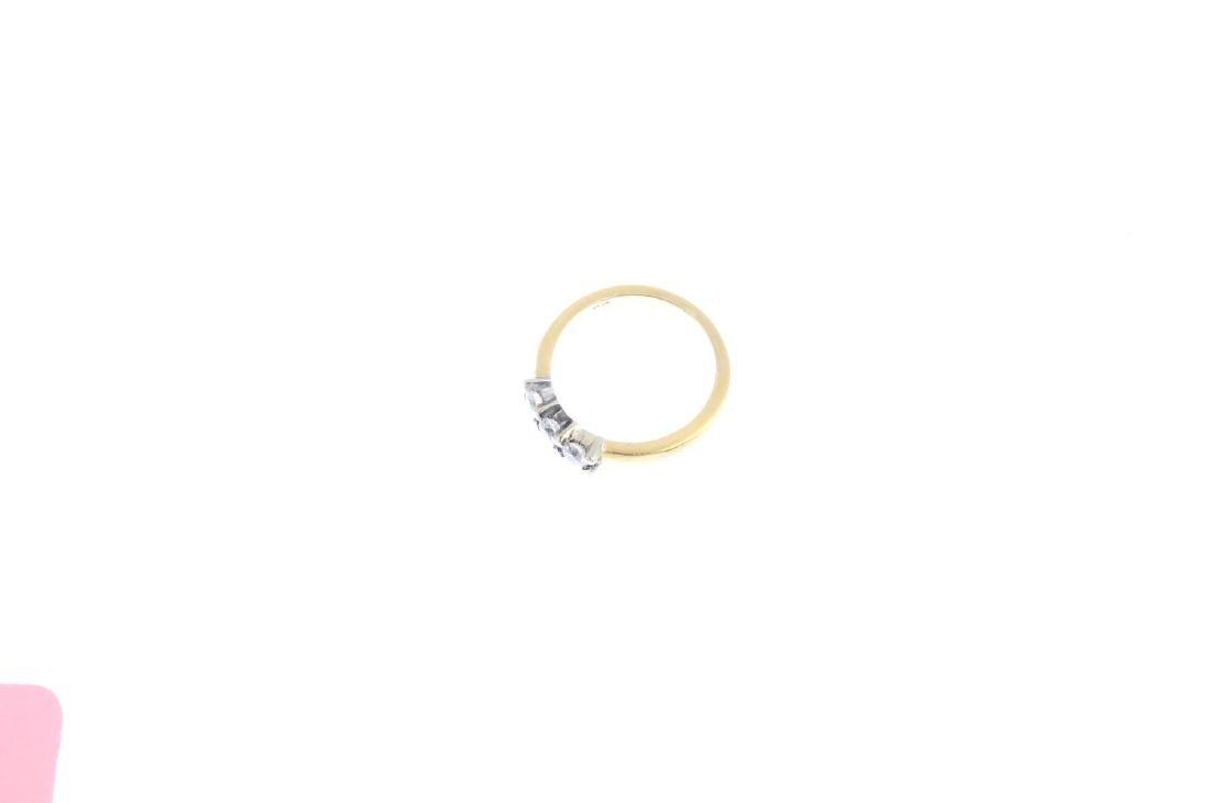 An 18ct gold diamond three-stone ring. The - 3