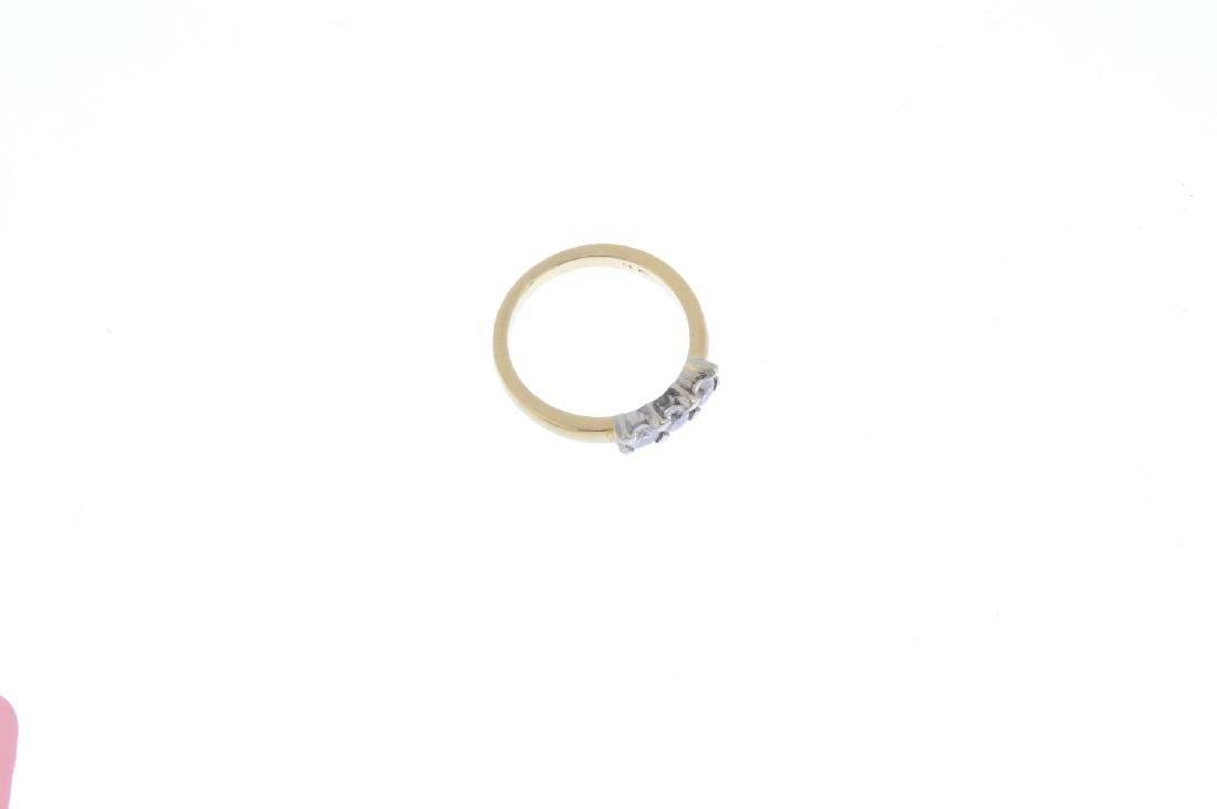 An 18ct gold diamond three-stone ring. The - 4