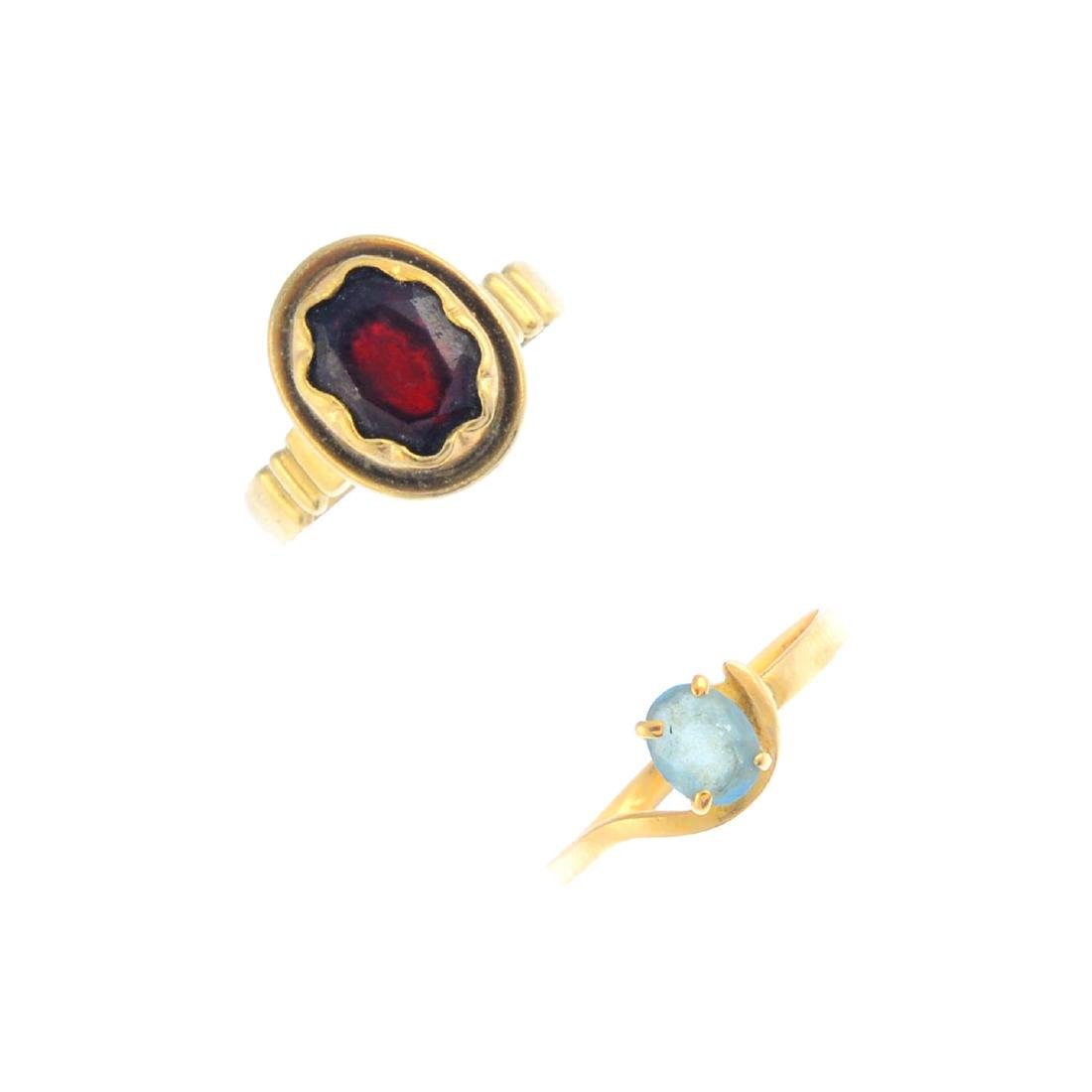 Two gem-set rings. To include an oval-shape garnet