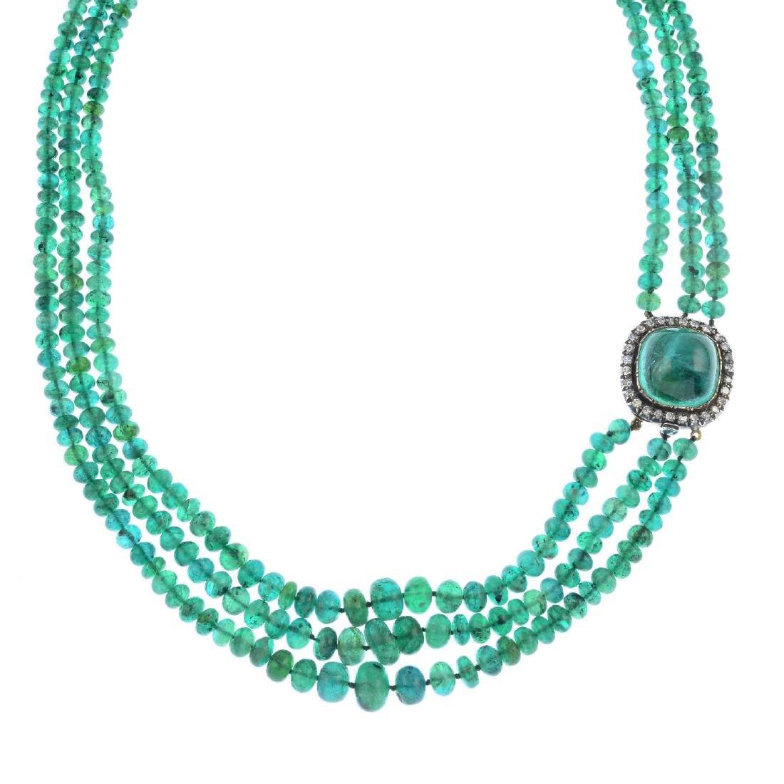 An emerald bead three-row necklace. Comprising three