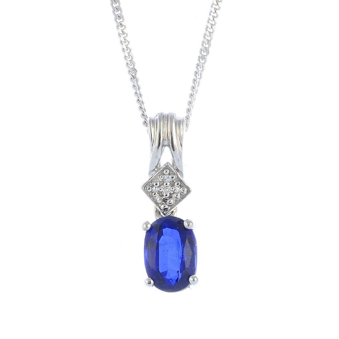 A 9ct gold kyanite and diamond pendant. The oval-shape