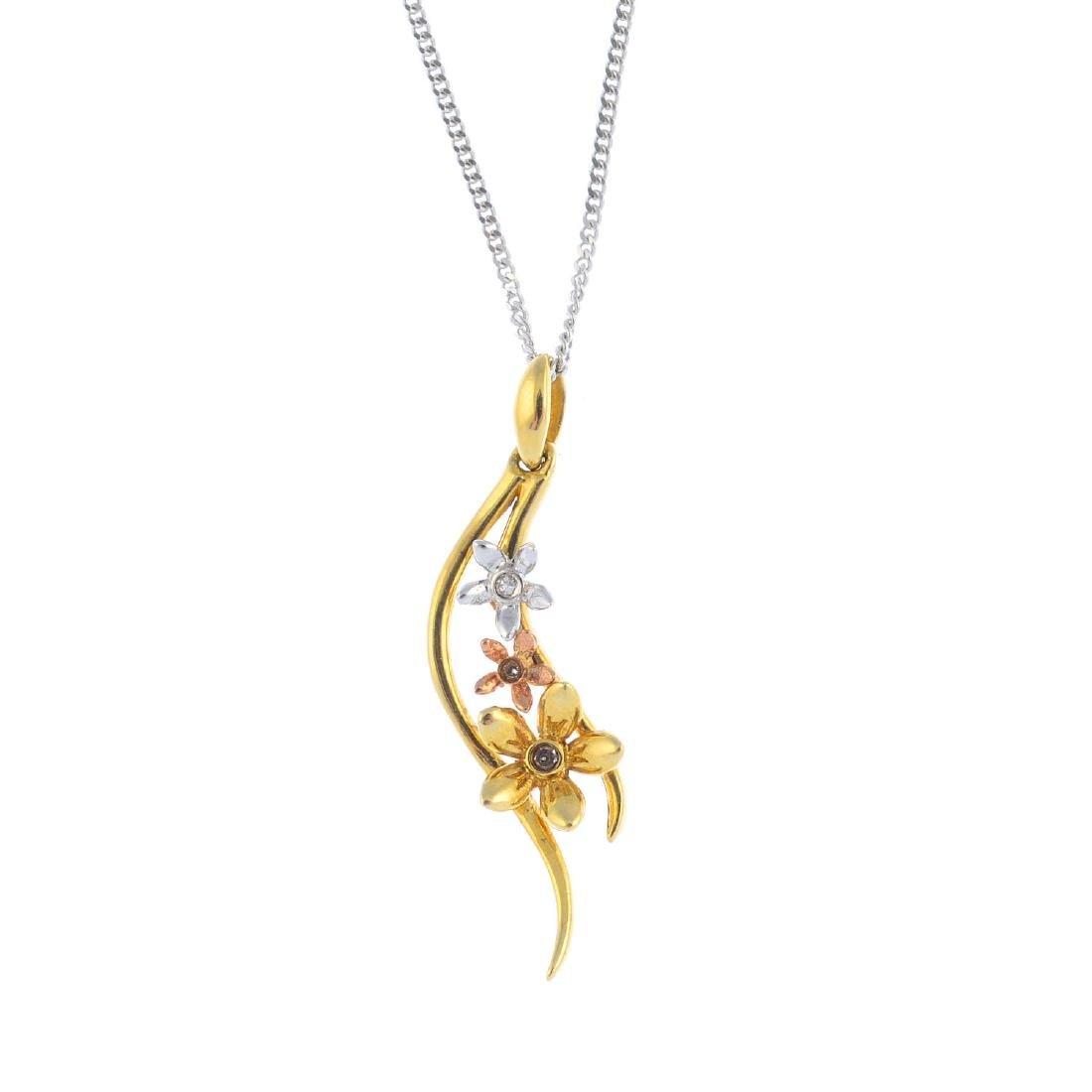 A 9ct gold diamond pendant. Of tri-colour design, the