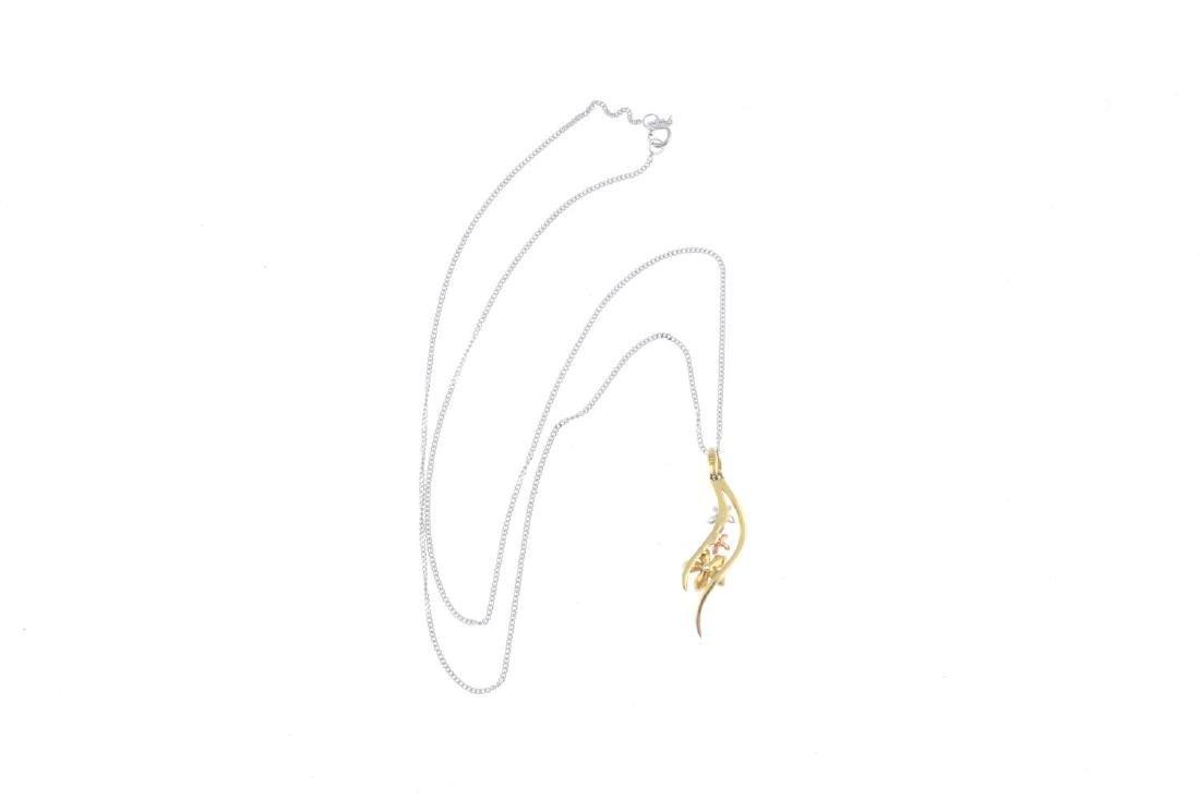 A 9ct gold diamond pendant. Of tri-colour design, the - 2