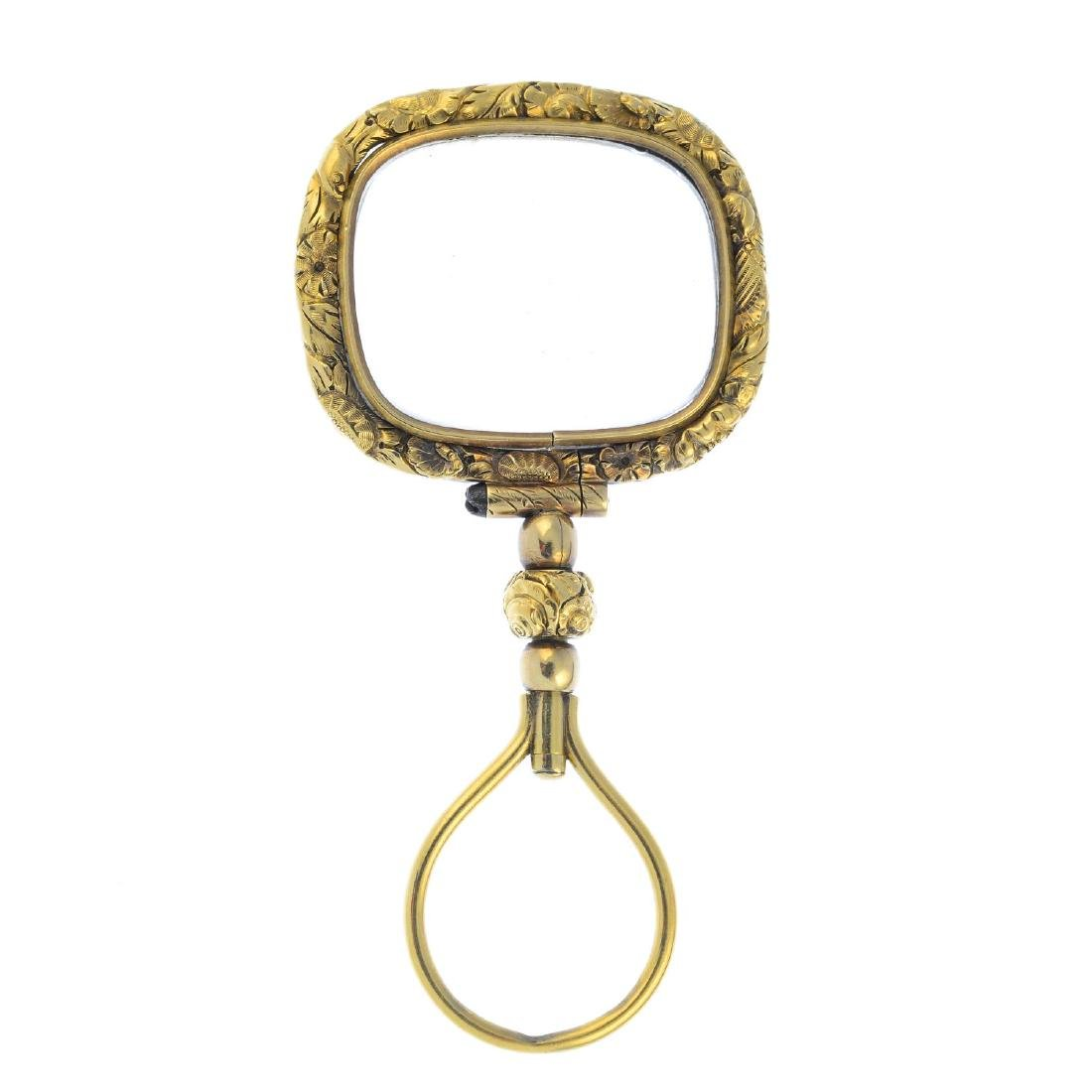 A mid Victorian gold magnifying glass. The