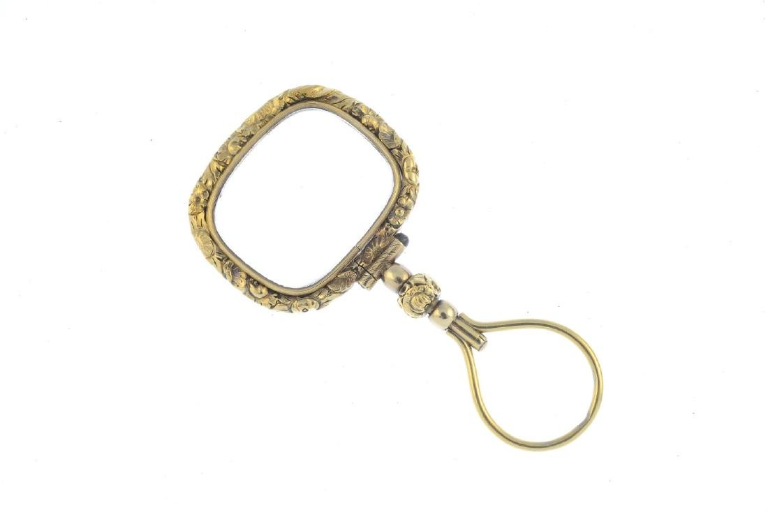 A mid Victorian gold magnifying glass. The - 2