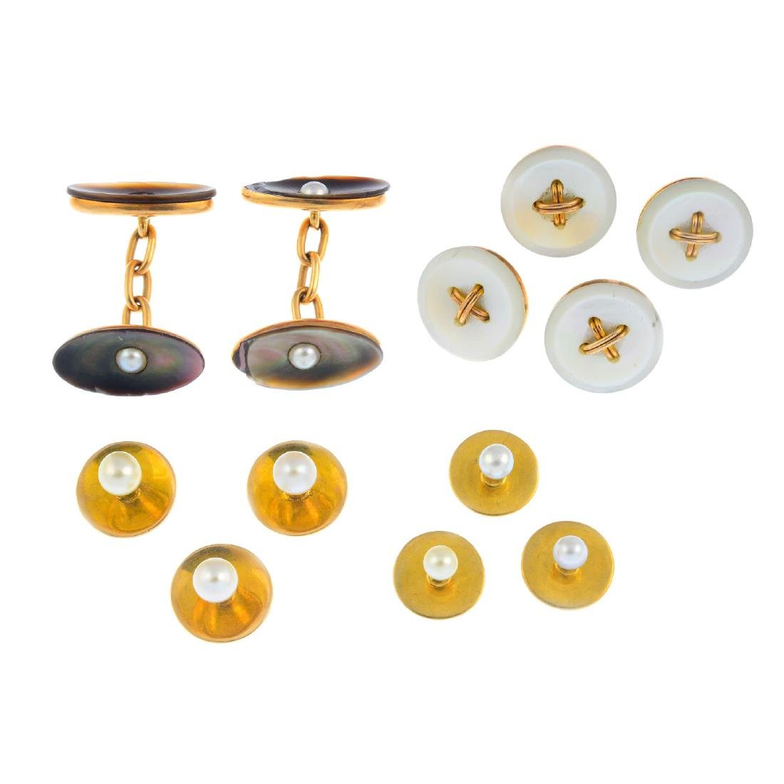 Four early 20th century gold dress-stud sets. To
