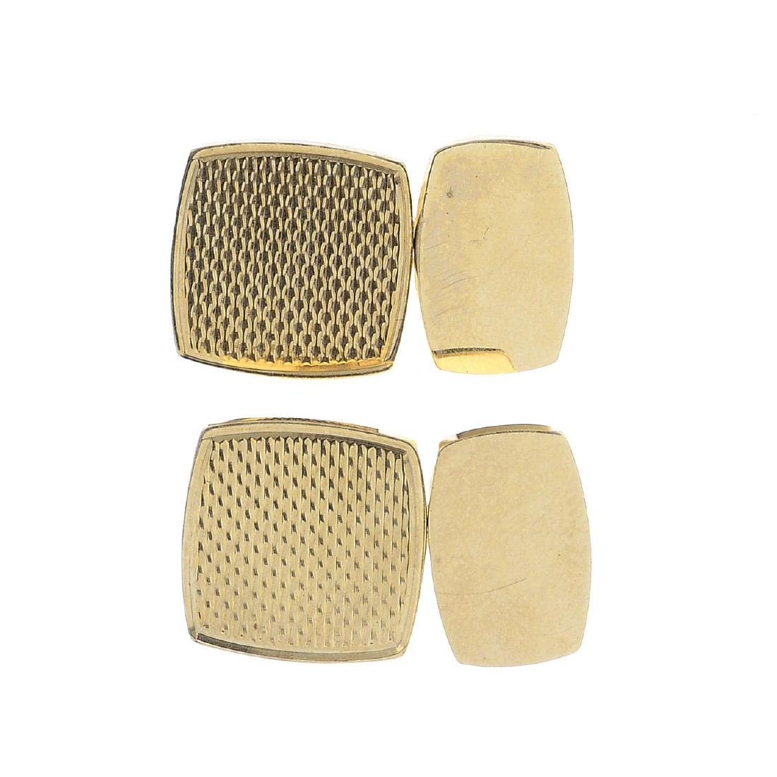A pair of 9ct gold cufflinks. Each designed as a