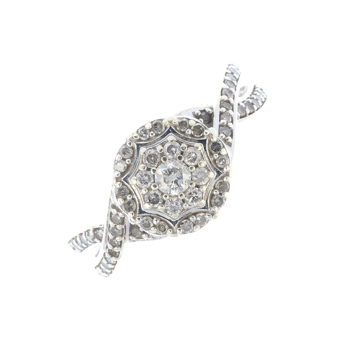 (52781) A 9ct gold diamond cluster ring. The