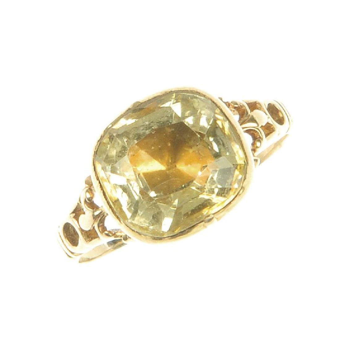 A George II gold citrine ring. The collet-set