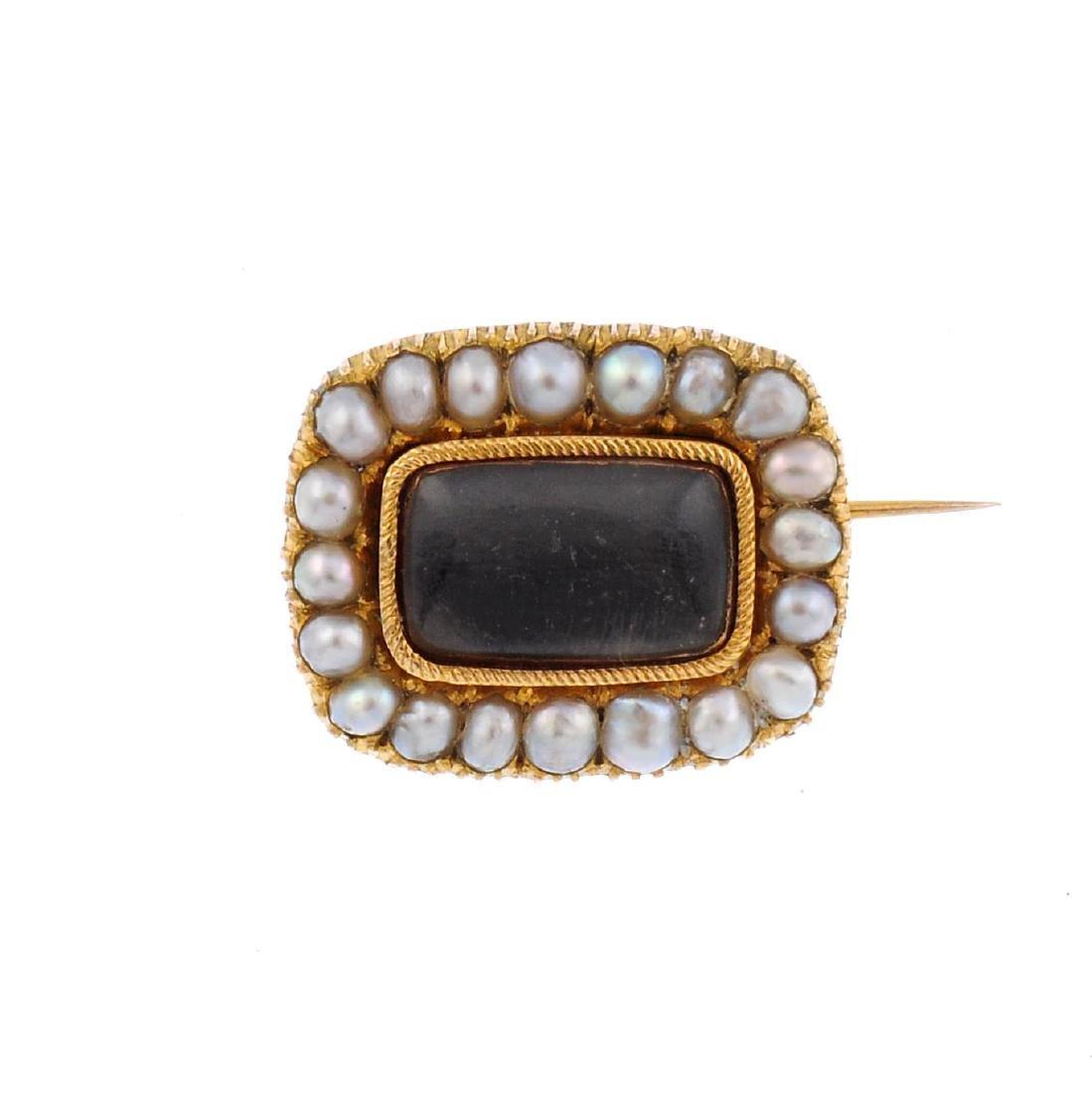 A late Georgian gold split pearl memorial brooch. Of