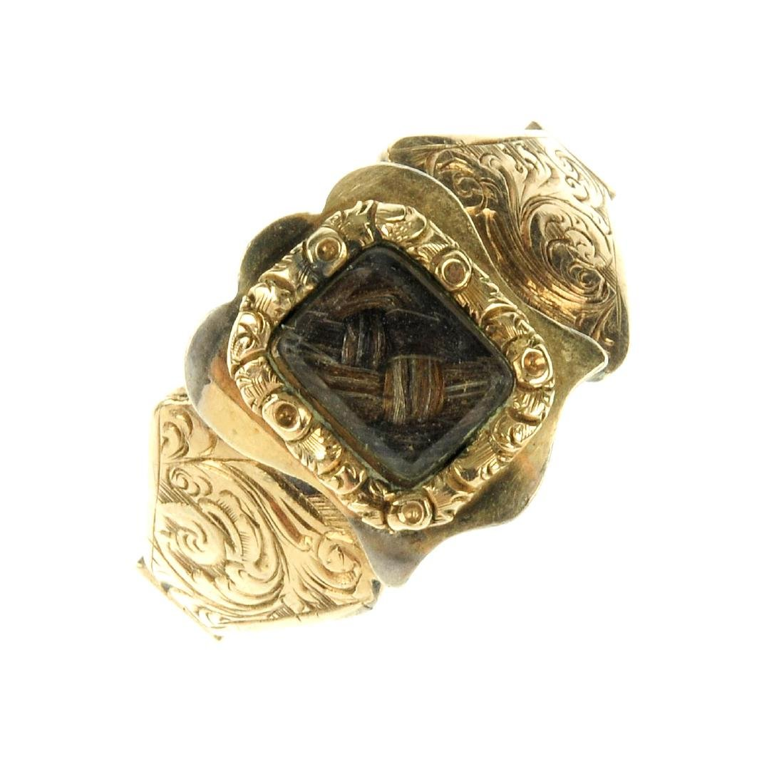 A mid Victorian memorial ring. The rectangular glazed
