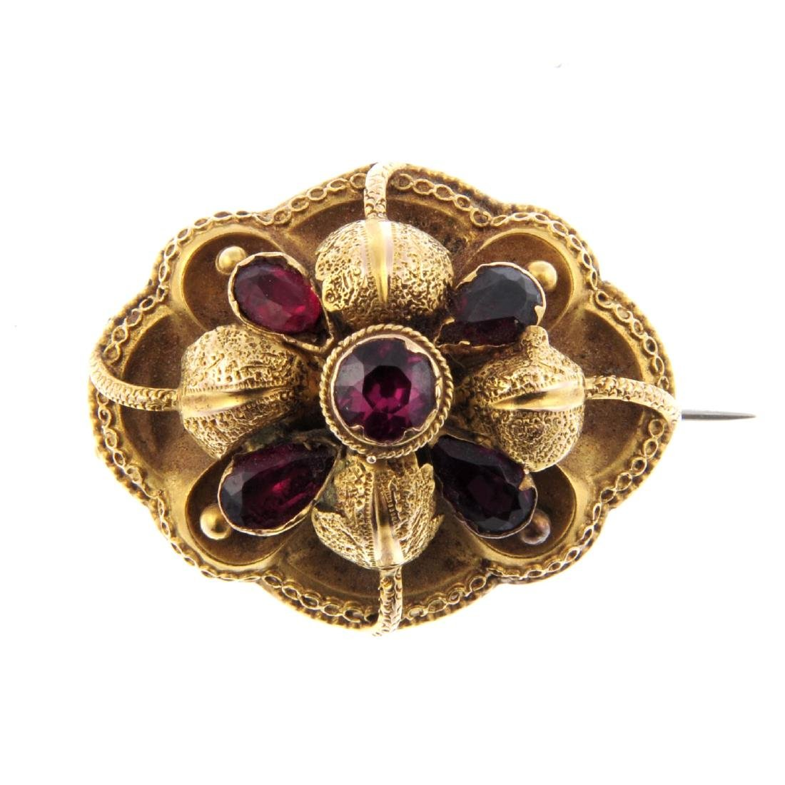A mid Victorian memorial brooch. With a garnet and