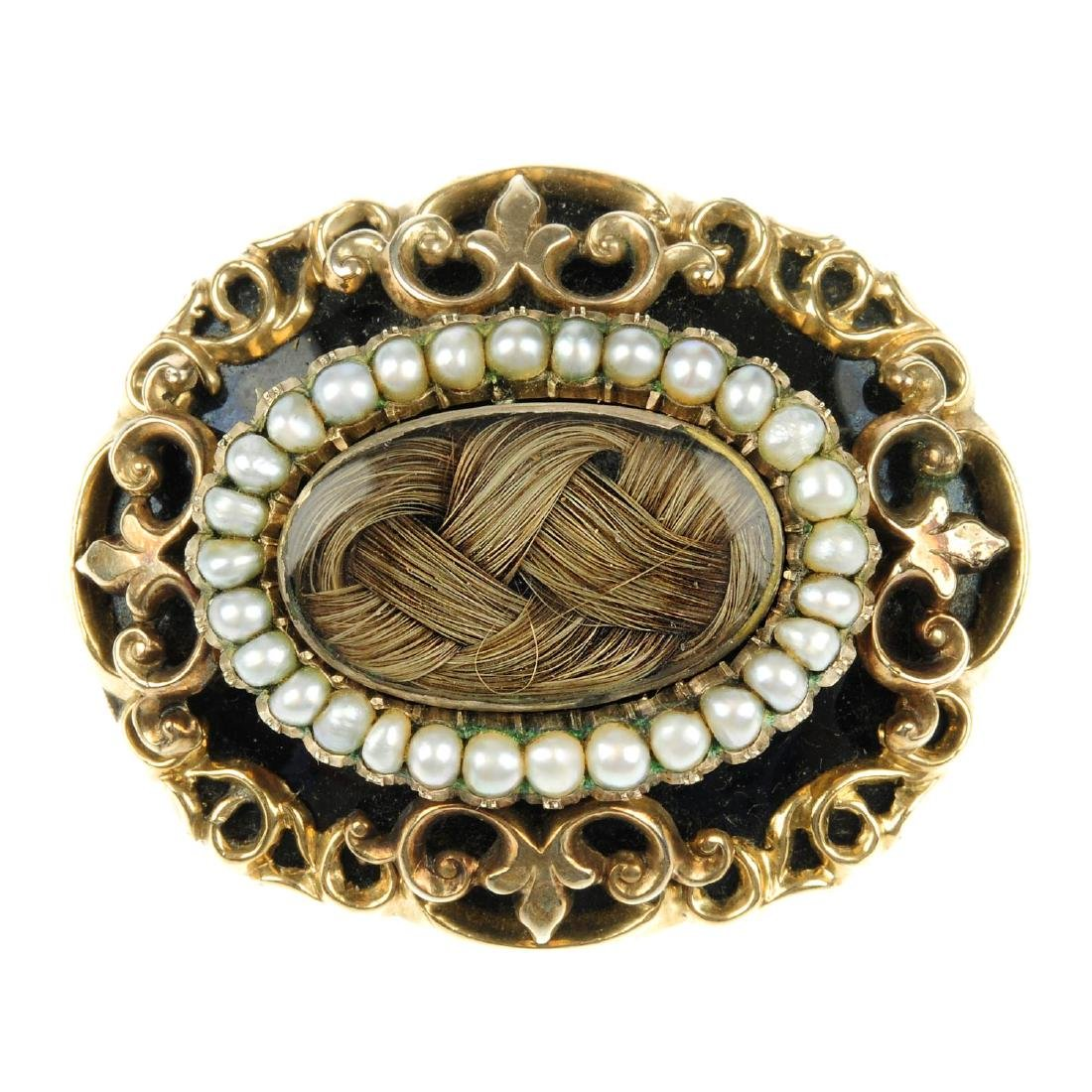 A late Victorian memorial brooch. Of oval outline, the