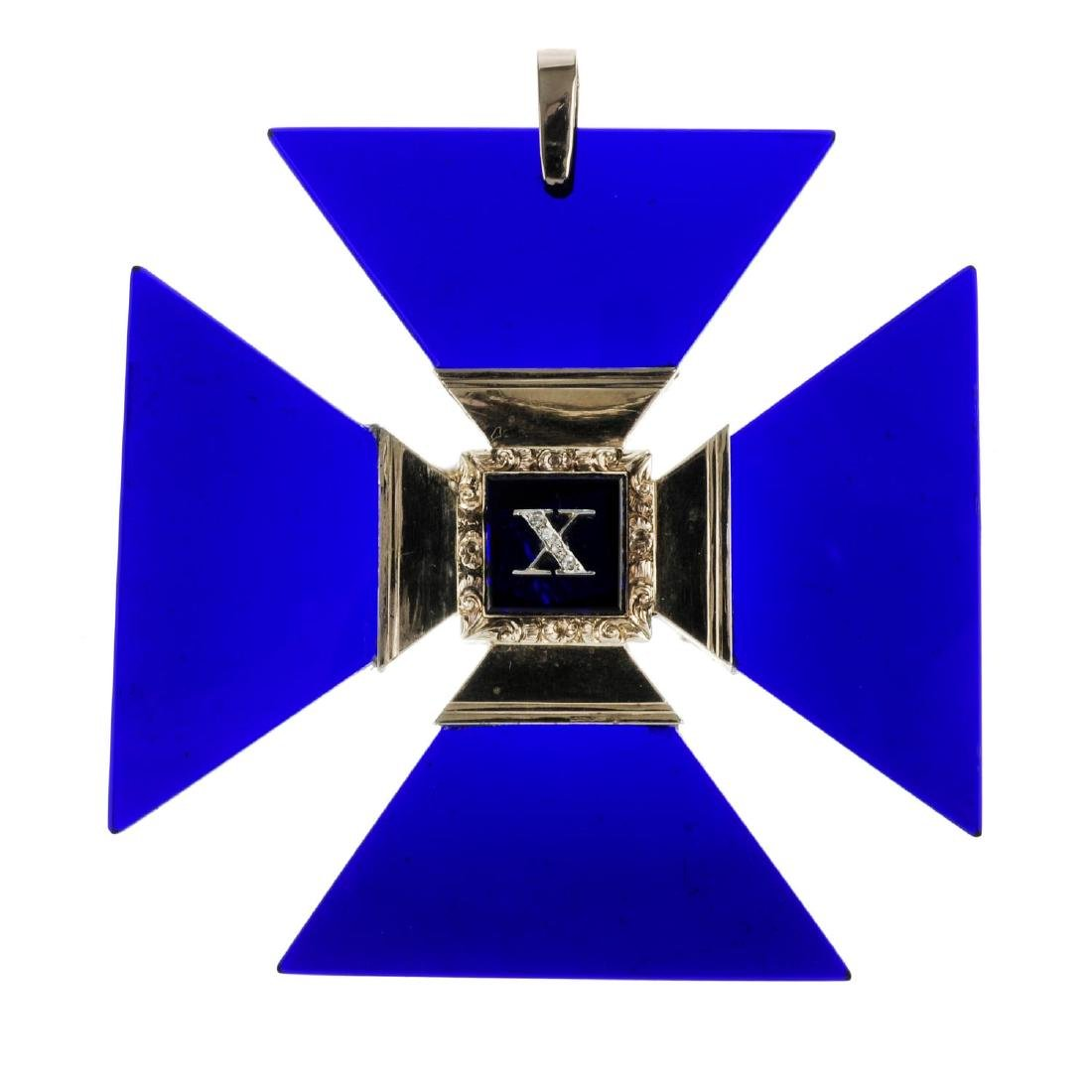 A Maltese Cross memorial pendant. Designed as a late
