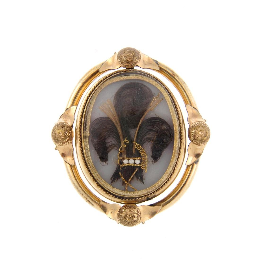A late Victorian mourning swivel brooch. Of oval