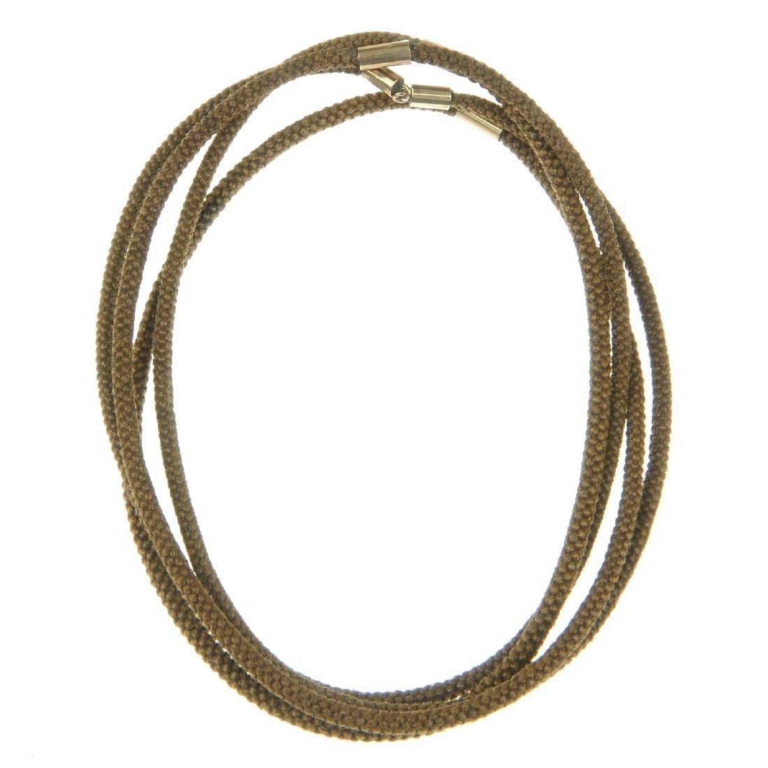 A late Victorian woven hair chain. The long-length