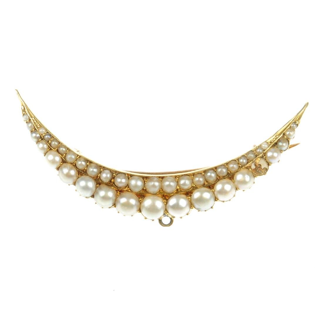 A split pearl brooch. Of crescent shape, designed as