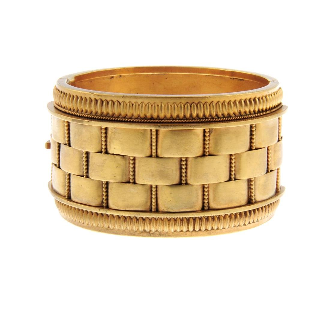 A late Victorian hinged bangle. Designed as a wide