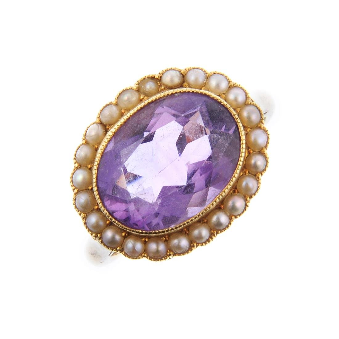 An amethyst and split pearl ring. Designed as an oval