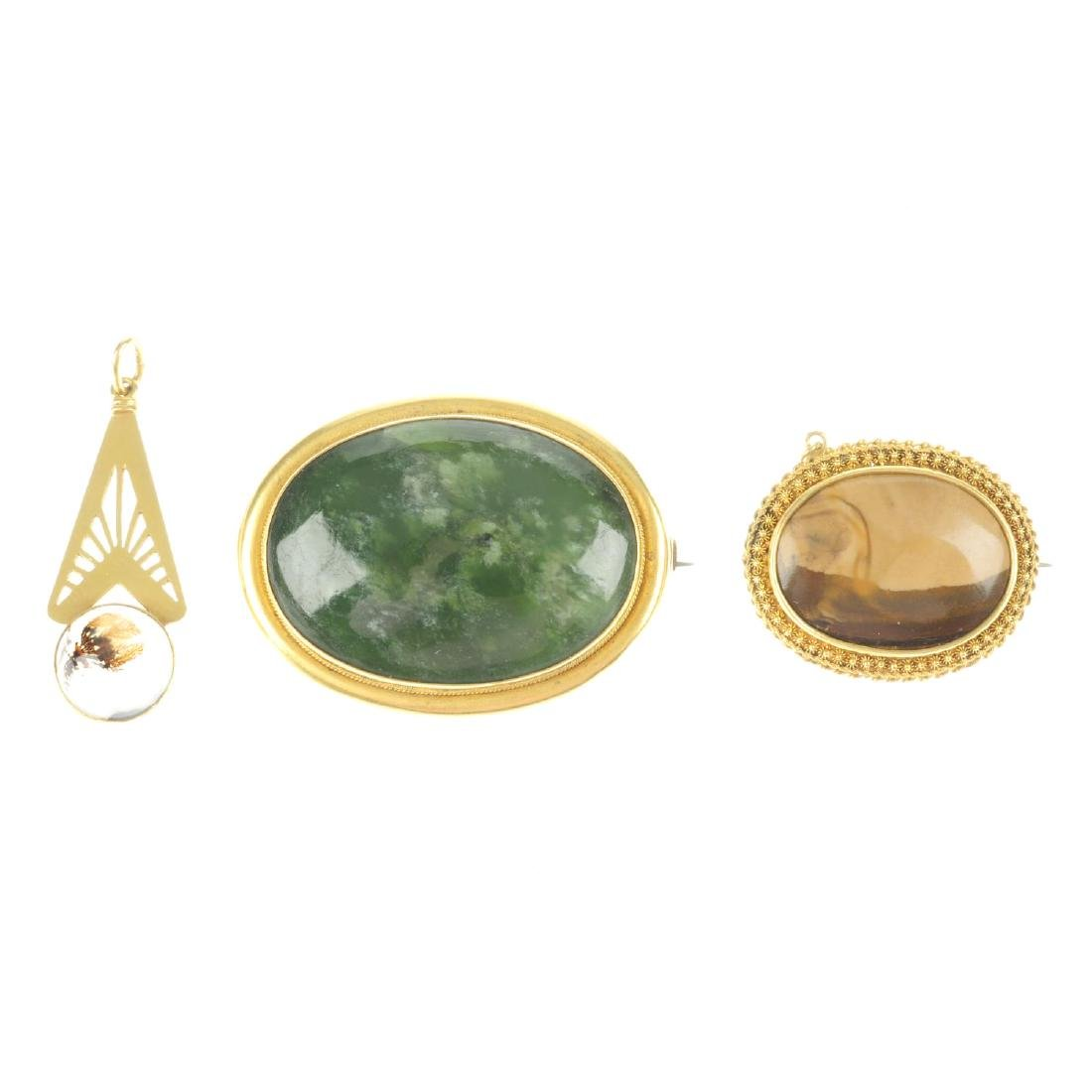 Two hardstone brooches and a hardstone pendant. The