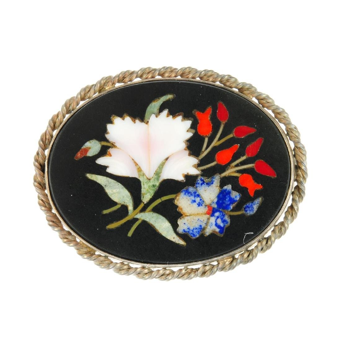 A pietra dura brooch. Of oval outline, the onyx panel