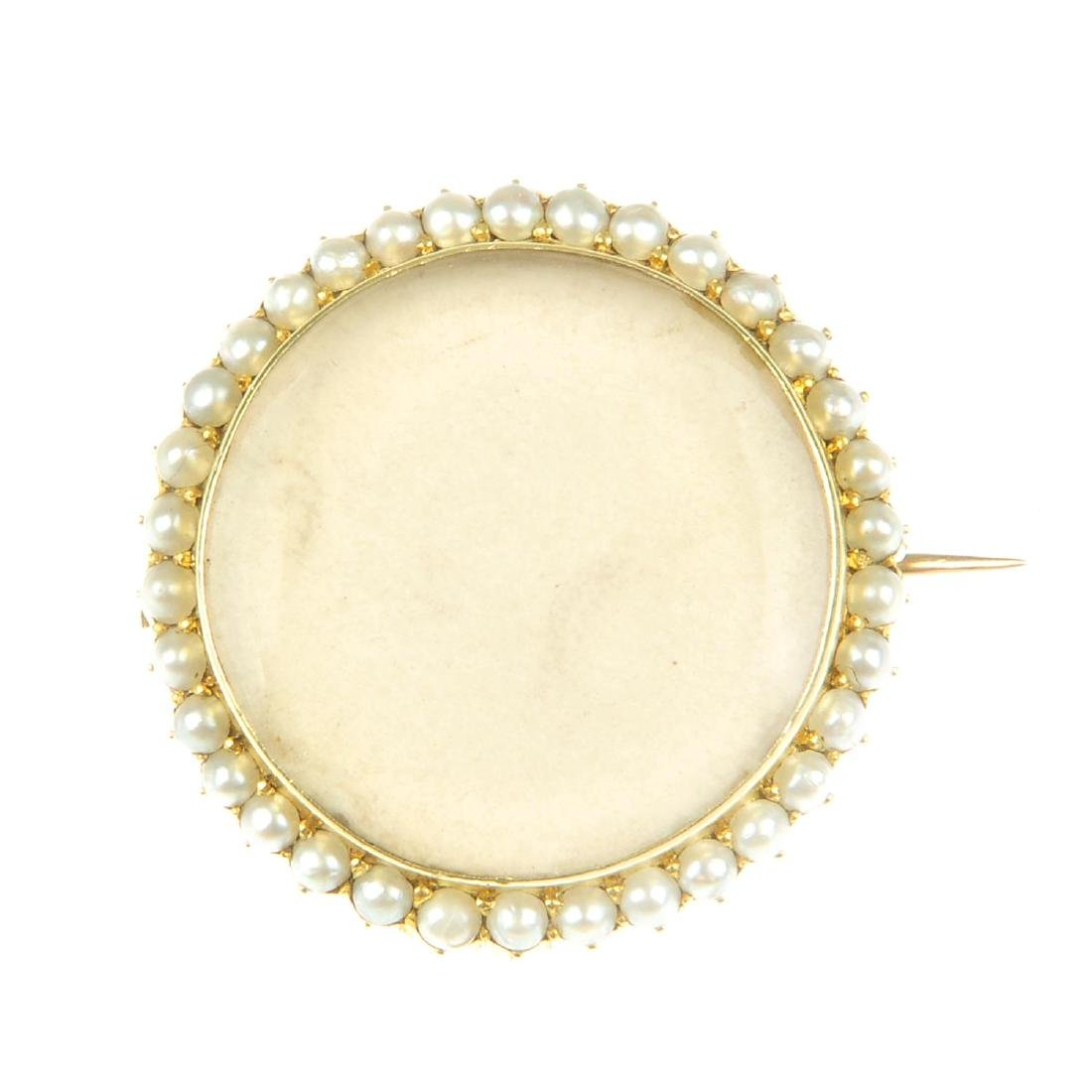 An early 20th century gold seed pearl brooch. Of