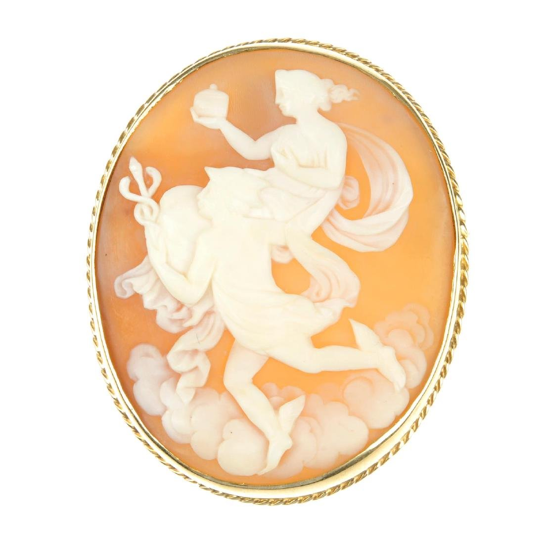 A cameo brooch. Of oval outline, the carved shell panel