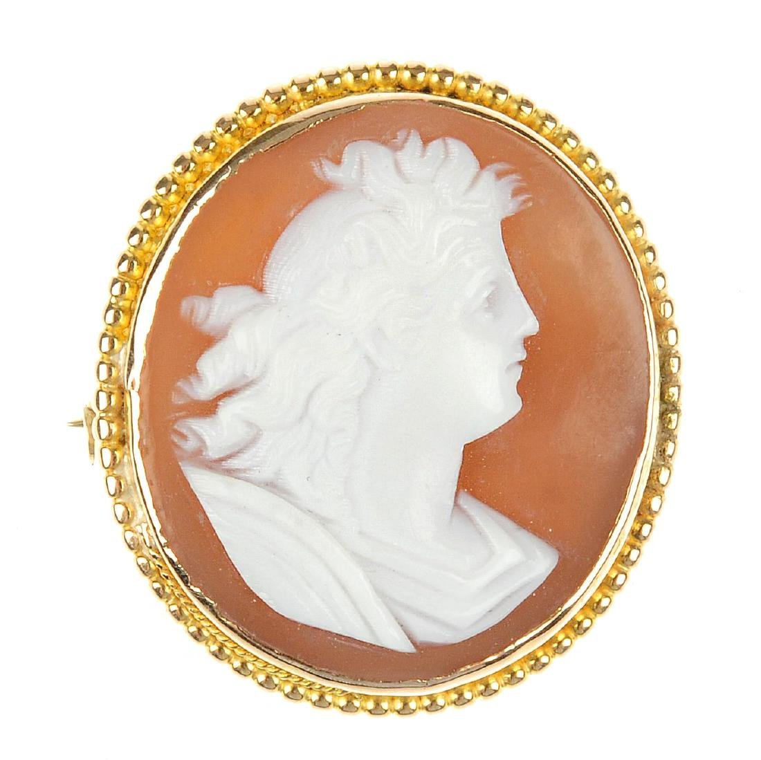 A cameo brooch. Of oval outline, the shell panel