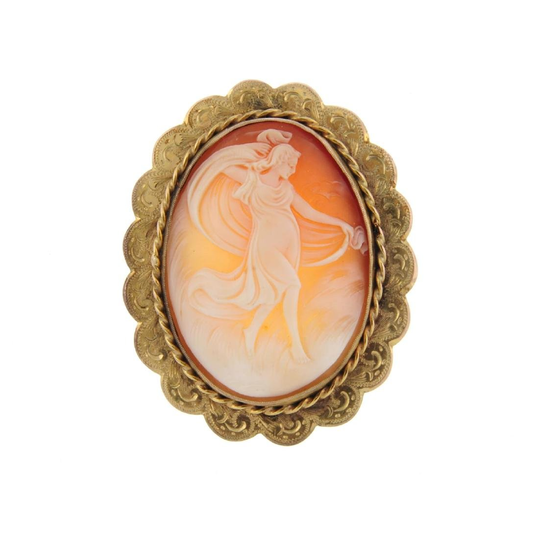 A cameo brooch. Of oval outline, the cameo panel
