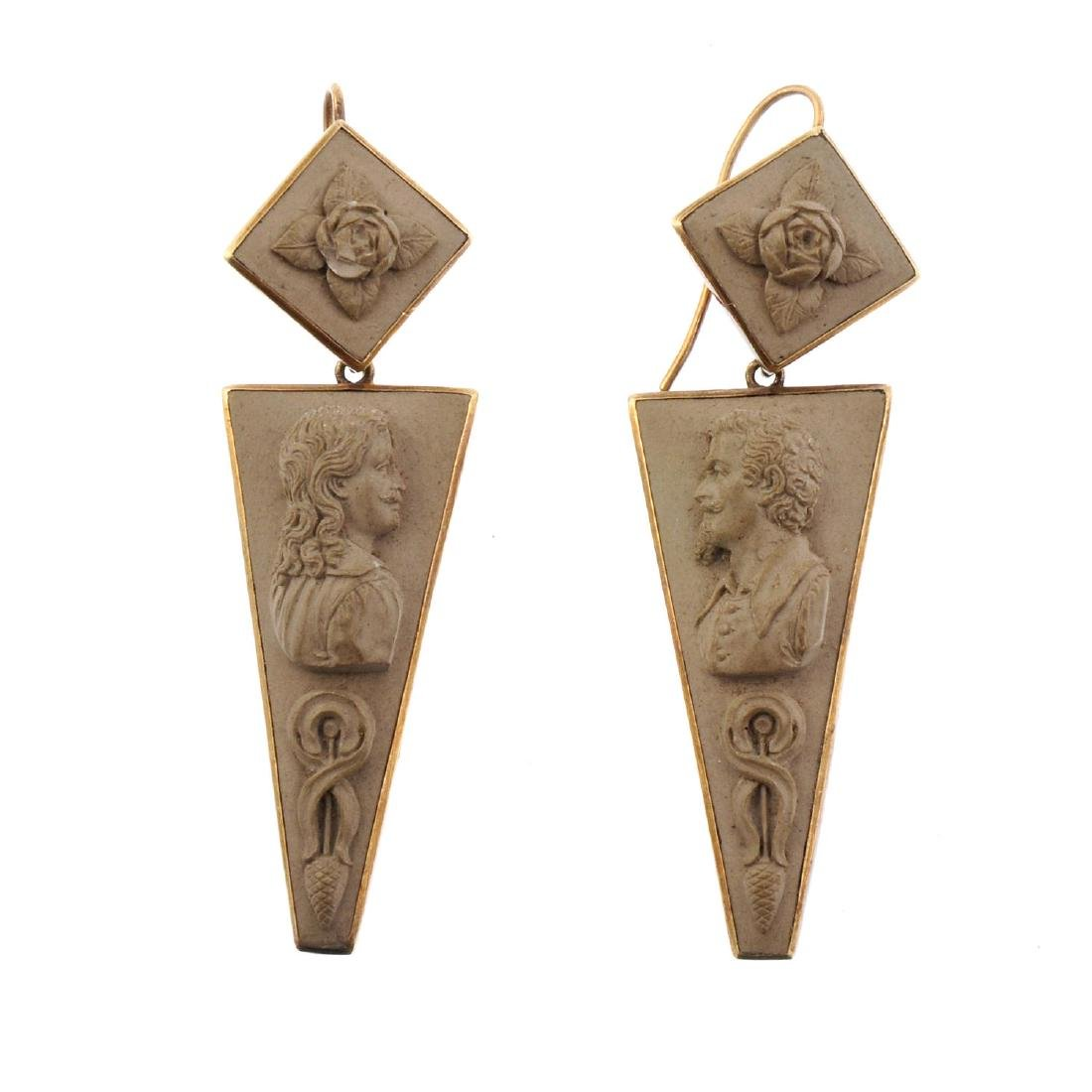 A pair of lava cameo earrings. Each designed as a