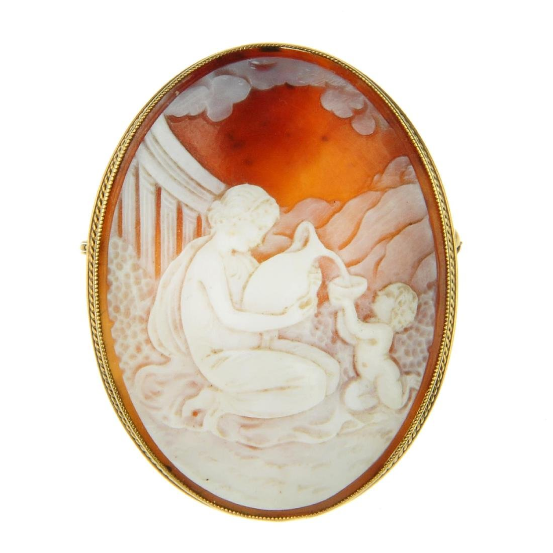 A 9ct gold cameo brooch. Of oval outline, with a